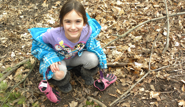 tbg kid kneeling in the woods