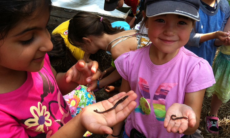 kids holding worms