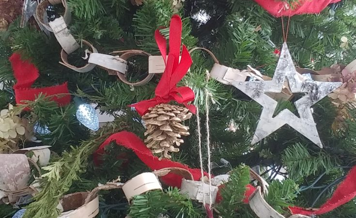 Pine cone christmas ornament on a tree